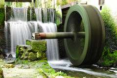Waterwheel and waterfall Stock Photo