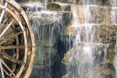 Waterwheel and waterfall Royalty Free Stock Photos