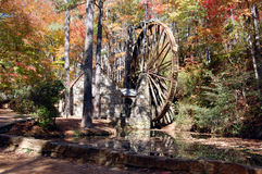 Waterwheel in the woods. Large waterwheel in the autumn woods at Berry College, Rome, Georgia Stock Images