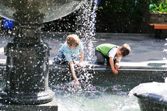 Waterworks play of boys Royalty Free Stock Photo