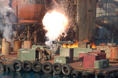 Waterworld. Stuntman Brian Collins tries to escape from a big explosion in a live stunt show Stock Images
