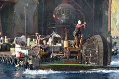 Waterworld. Stuntman is in action in a live stunt show Stock Image