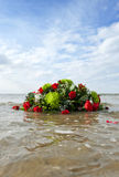 Watery grave. Bouquet of flowers, adrift in the sea, representing a watery grave Royalty Free Stock Photo