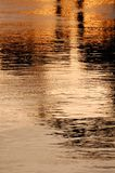 Watery reflections at sunset Stock Photography