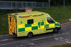 Ambulance in rush on the street. Watford, UK - October 5, 2017: Ambulance in rush on the street in the town royalty free stock image