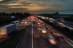 M1 motorway at dusk. Watford, UK - September 24, 2017: Evening traffic jam on British motorway M1.M25/M1 junction royalty free stock images