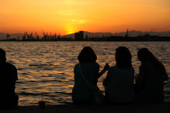 Wathcing the sunset. Tree girls watch the sunset Stock Images