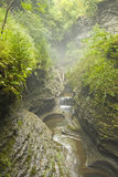 Watkins Glen Gorge. A bridge and waterfall in Watkins Glen royalty free stock photography