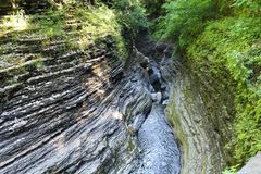 Watkins Glen gorge view from the trail. Steep walls of the gorge looking down at Glen Creek stock photos