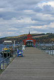 Watkins Glen Municipal Pier. A view toward the end of the municipal pier in Watkins Glen, on Seneca Lake. Seneca is one of the Finger Lakes, and is central to royalty free stock photography