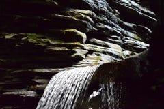 Water falls through the rocks at Watkins Glen, NY State Park Stock Images