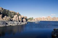 Watson Lake. Blue sky, blue water, and colorful round boulders form the iconic landscape of Watson Lake, near Prescott, Arizona Stock Image