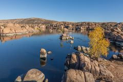 Watson Lake in Autumn Prescott Arizona. Scenic watson lake near prescott arizona with interesting granite rock formations and fall foliage along the shore Royalty Free Stock Photo