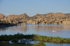 Watson Lake Prescott Arizona. Scenic watson lake near prescott arizona with interesting granite rock formations and kayaks Royalty Free Stock Images