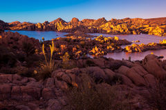 Watson Lake, Rock Formations Sunset. Watson lake in Prescott Arizona, rafting, boating and recreation. Granite boulders and very rock on banks. Island with tree Royalty Free Stock Photo