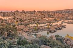 Watson Lake Siunset. A colorful sunset on the granite rocks surrounding Watson Lake Prescott Arizona Stock Photos