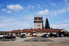 Watson Lake, Yukon, Canada airport tower. Watson Lake, Yukon, Canada airport with World War Two era tower and blue skies royalty free stock image