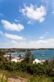 Watsons Bay. Near Sydney on a summers day is packed with people and boats anchored in the bay as people explore the blue waters, coffee shops and restaurants Royalty Free Stock Photos