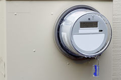 Watt Meter. Close-up of a digital energy monitor on the exterior of a residential home Stock Photos
