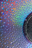 Watter drops on cd. Abstract colored watter drops closeup on cd Royalty Free Stock Images
