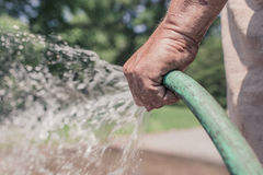 WATTER FROM GARDEN HOSE Stock Images