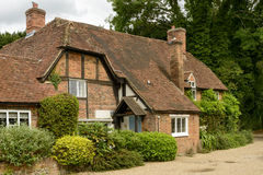 Wattle cottage, Whitchurch on Thames. View of old brick and wattle cottage in touristic village on river Thames, shot under cloudy yet bright sky stock photography