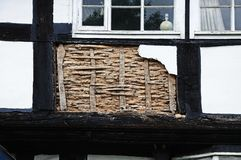 Wattle and Daub architecture, Pembridge. Small panel of wattle and daub being restored on a traditional white timbered building, Pembridge, Herefordshire Stock Images