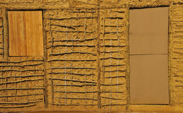 Wattle-and-Daub construction details. Wattle and daub (or wattle-and-daub) is a building material used for making walls, in which a woven lattice of wooden Royalty Free Stock Photography
