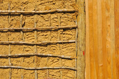 Wattle-and-Daub construction details. Wattle and daub (or wattle-and-daub) is a building material used for making walls, in which a woven lattice of wooden Royalty Free Stock Photos