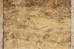 Wattle-and-daub wall of a residential village house made of straw and clay.  Royalty Free Stock Image