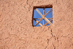 Wattle and daub wall with window. Background Royalty Free Stock Photo
