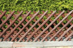 Wattle fence in Garden. Garden wooden fence. Wattle fence in Garden. Garden wooden fence royalty free stock image