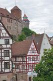 Wattle houses and castle, nurnberg. View of old wattle houses in city center with the ancient castle on background Stock Photo