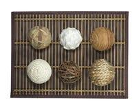Wattled balls on bamboo carpet Stock Photo