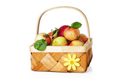Wattled basket full of ripe apples Stock Photos