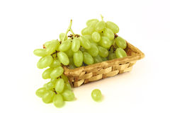 Wattled basket with grapes Stock Photo