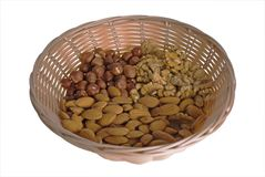 Wattled basket with nuts Stock Photo