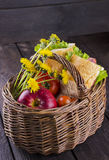 Wattled basket for picni. C with sandwiches, apple, tomatoes and yellow flowers Royalty Free Stock Image