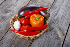 Wattled basket with vegetables on an table Stock Photo