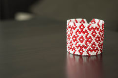 Wattled bracelet from red and white beads Royalty Free Stock Photo