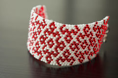 Wattled bracelet from red and white beads Stock Photo