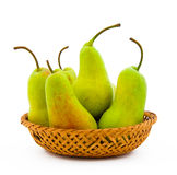 Wattled dish filled with ripe pears Royalty Free Stock Photography
