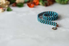 Wattled necklace from beads of turquoise and brown color Stock Image