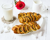 Wattled rolls with poppy on a white plate Stock Photos