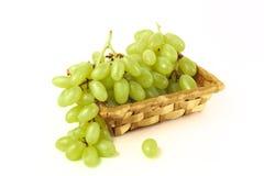Wattledmand met druiven Stock Foto