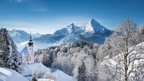 Watzmann mountain with pilgrimage church of Maria Gern in winter Royalty Free Stock Image