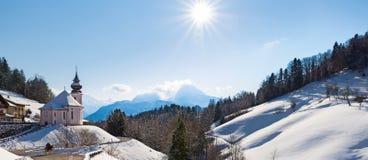 Watzmann at noon with church, Bavaria, Berchtesgaden, Germany. Alps Royalty Free Stock Photography