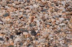 After the wave. Beach stones on the coast Royalty Free Stock Photo
