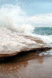 Wave. Icy shore of the sea - in winter sea climate Royalty Free Stock Photography