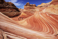 The Wave. Three hikers exploring The Wave in the Coyote Buttes section of the Paria Canyon-Vermilion Cliffs Wilderness in northern Arizona and southern Utah Royalty Free Stock Photography